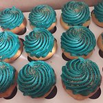 vanilla with teal frosting and gold sand glitter