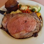 Prime rib 10 oz cut with potatoes and veggies- a scorched popover as well.