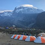 Our ClimbKili camp with Mount Kilimanjaro in the background.