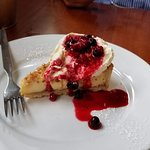 Coconut custard and raspberry tart