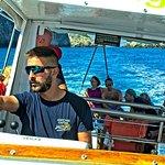Our Skipper, Antonis navigates the waters around Thodourou Island