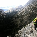 Ledge walk, headed down, holding safety cable (thrilling but not terrifying!)