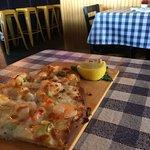 Tasty seafood alfredy flat bread