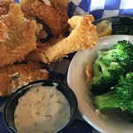 Battered Fish and perfectly done broccoli.
