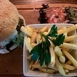 Chefs beef burger with onion ring & salad served with fries