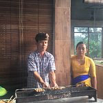 Cooking the grounded chicken satay skewers that we prepared
