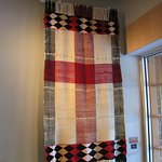 blanket displayed on wall