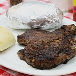 Ribeye Steak (available after 5pm) Baked Potato and a Dinner Roll