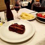 Steak, mashed potatoes and salad.