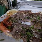 lamb carpaccio - thinly sliced oven-cooked meat pieces