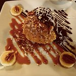 Deep fried ice cream with hot fudge and carmel rum sauce