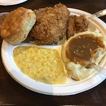 Fried chicken, creamed corn, mashed potatoes w/ gravy, biscuit