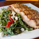 Kale & Quinoa Salad topped with Grilled Salmon