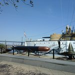 On the dock looking at the front of the USS Olympia.