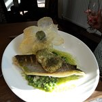 Sea Bass Fillet with herb crusted poached egg and Dauphinoise potatoes