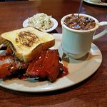 Beef brisket platter with cole slaw and baked beans