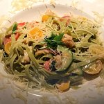 Seafood Medley with Spinach Fettuchini Zucchini & Tomatoes