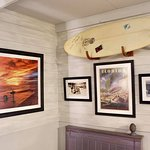 New decor includes local photography and memorabilia like this surf board signed by The Beach Bo