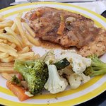 Jerk Chicken With Fries And Steamed Garlic Vegetables