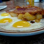Sunny-side up with bacon and home fries
