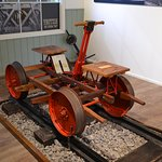 """Working exhibit. Note the chain to stop the kids from """"de-railing"""" the Handcar (Velocipede).."""