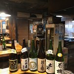Six huge bottles of sake lined up for us to try