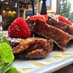 Grandma's slow cooked french toast bread pudding with fresh strawberry's and toasted coconut