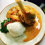 Slow Cooked Lamb Shark served with massaman curry sauce.
