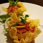 Grilled Scallops topping with chilli jam sauce and served with wonton paper.