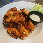 Mild chicken wings. A very popular side with our delicious pizza.