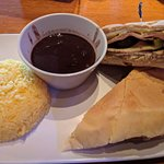 Cuban Sandwich served with black beans and yellow rice