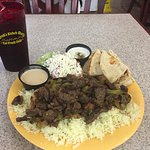 The shawarma plate comes with a nice salad, dressing, rice, and a warmed pita with its own sauce