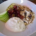 Beautifully presented yogurt, fruit and granola breakfast.  Lovely mix.