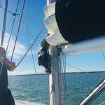 Mandy doing something up the mast!
