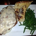 country fried steak with mashed potatoes, country gravy, garlic green beans & garlic bread