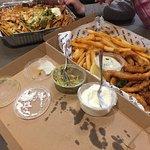 Calamari and fries, with overcooked nachos