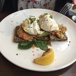 Toasted nut break with avocado and poached eggs