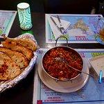 Hot, spicy generous portion of chicken briyani w/cold yogurt sauce, garlic naan, and a Heineken.