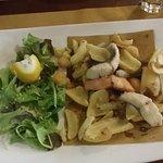 Greek salad with a fish platter.
