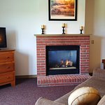 This is our KGFP room w/ 1 King Bed, sofa & a fireplace