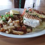 Grilled panini wrap with bacon, scrambled egg, cheddar, mayo, tomato, spinach; with hash browns!