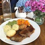 Roast beef, potatoes, mushy peas and carrots