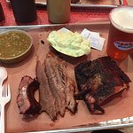 two meats (brisket, ribs), sides (green chli stew, potato salad), Schlaflys Octoberfest
