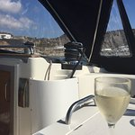 Enjoying a glass of white wine as we sailed the sea