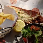 Missing meat from lobster, half a tiny basket of cold chips