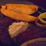 Ribeye (overcooked) with barn taters.