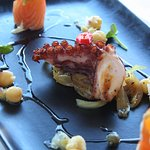 New Special -Duo of Octopus served on a bed of Caramelised onion and house Salmon, chick peas