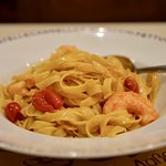 Tagliatelle with shrimps, garlic, red sweet pepper, ouzo and cream sauce.