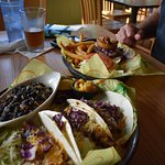Fish Tacos with beans & rice and Marley Burger in back