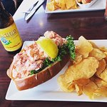 Massive lobster roll with homemade potato chips & cold Pacifico!! yum.